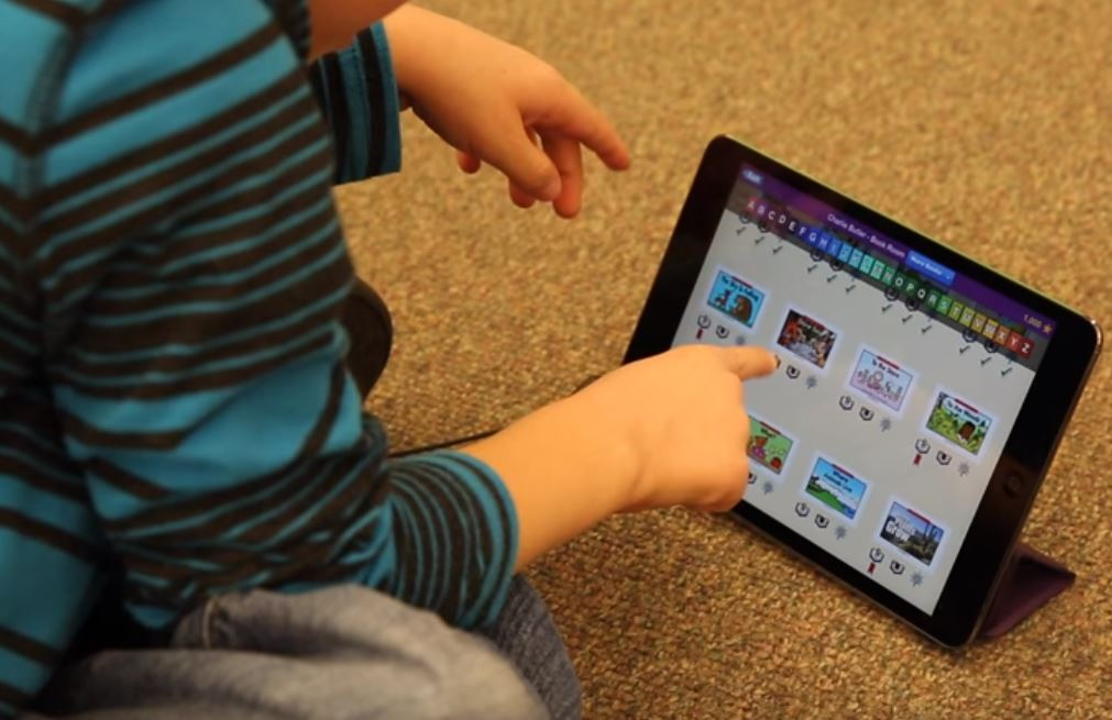 kindergartner using an iPad