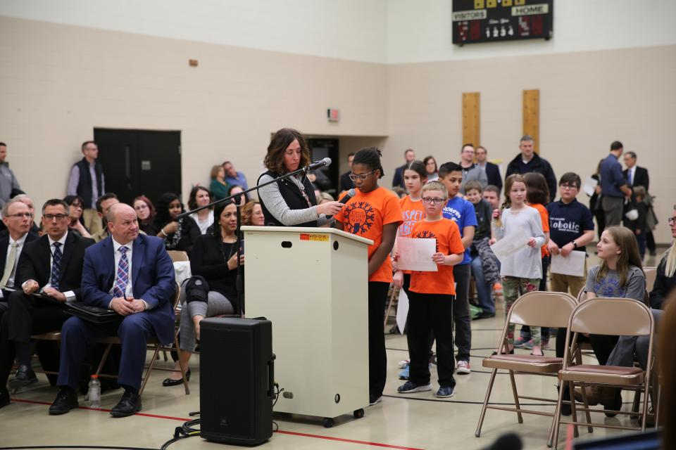 Principal Christy Campbell & Elsie Rogers students updating the Board