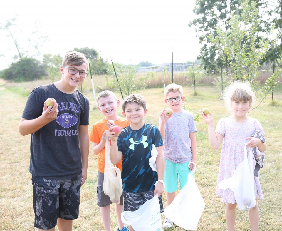 Horizon students with Discovery student who helped plant the orchard