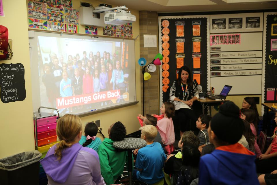 Mrs. Lindsay Helman's 4th grade class watching a Mustang Gives Back video