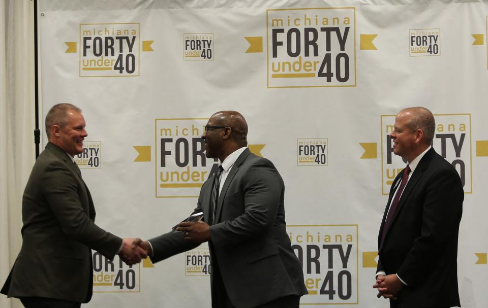 "Randy Williams receiving his ""Forty Under 40"" award"