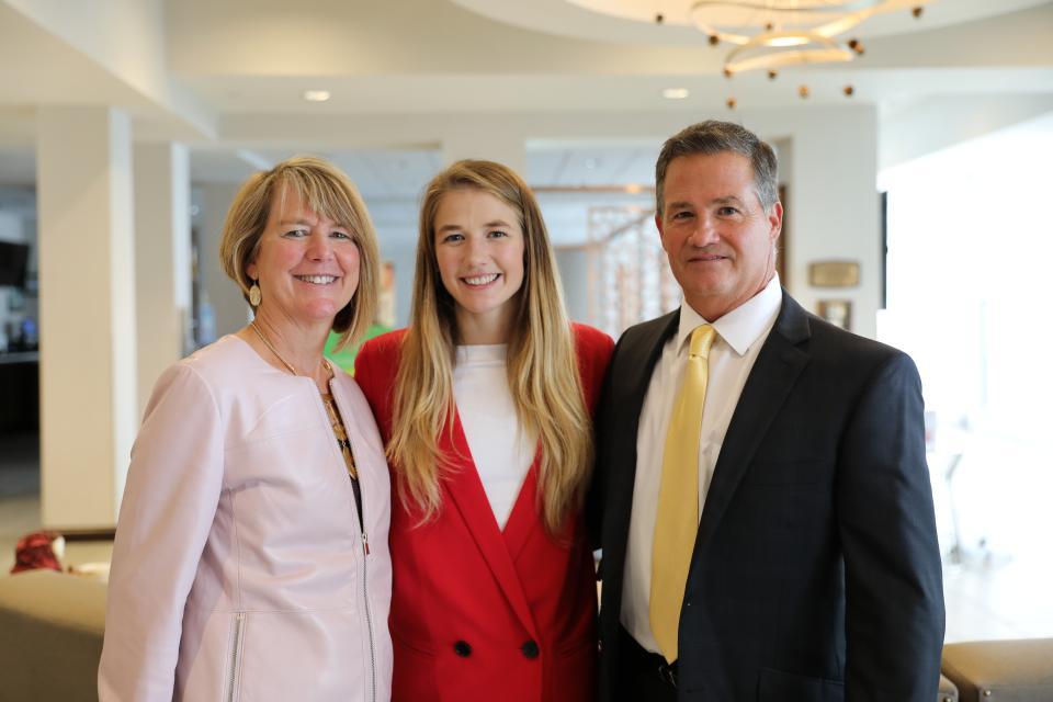 Sarah Hildebrandt with her parents Nancy and Chris