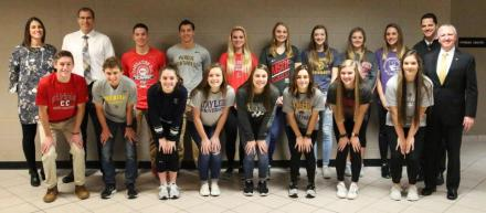 P-H-M Supt. Dr. Jerry Thacker, Principal Sean Galiher, AD Aaron Leniski and AAD Bridget Williams with Penn's 15 student-athletes who participated in the NCAA Signing Day.