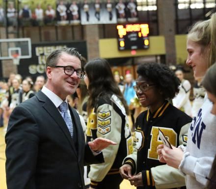 P-H-M School Board Pres. Chris Riley hands out Academic Letters in a ceremony Feb. 5, 2019