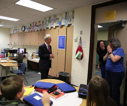 Dr. Thacker and Principal Dean-Null surprise Mrs. Lee Riley
