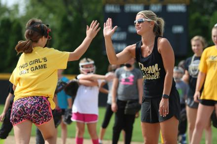 Penn Softball Coach Beth Zachary instructs campers