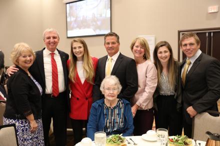 (left to right) Mrs. Donna Thacker, Dr. Jerry Thacker, Sarah Hildebrandt, Father: Chris, Mother: Nancy, Sister: Amy, Penn Wresting Coach Brad Harper, (sitting) Sarah's Grandmother