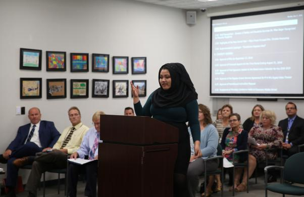 Penn High School Kingsmen Court Student/Board Ambassador Kia Heryadi gives her report to the Board