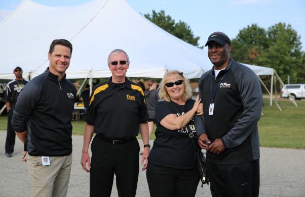 Principal Galiher, Dr. Thacker, Mrs. Thacker and Penn Asst. Principal Derrick White