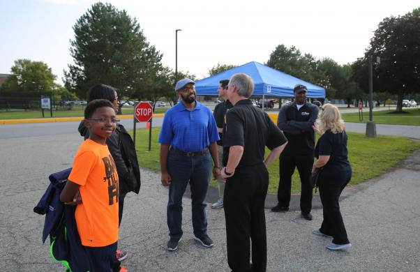 Dr. Thacker visits with Community Tailgate guests
