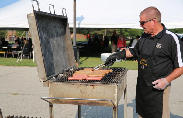 Energy Educator/Manager Rob Lovett working on the grill