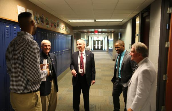 Grissom Teacher Mr. Taylor Williams visits with Larry Beehler,  Supt. Dr. Thacker, Grissom Principal Milfort and Jim Garret during 1st Day of School Visits (8/23/17)