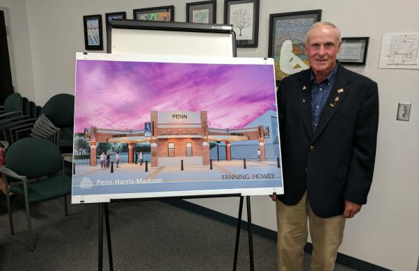 Larry Beehler with rendering of new ticket center to be named after him at Penn High School's TCU Freed Field at