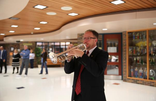 Band teacher Jeff Carnall plays