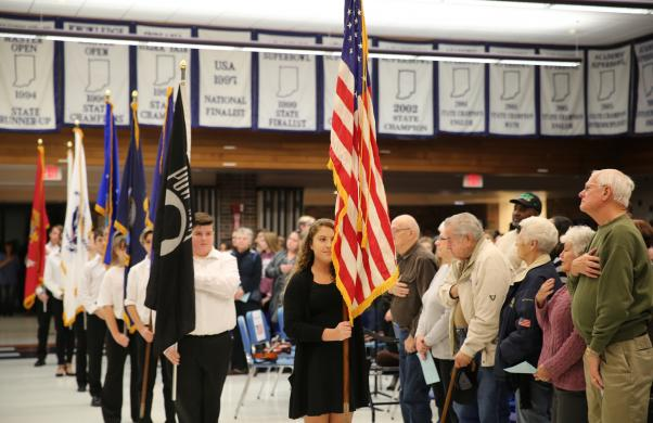 The American flag is presented at the Schmucker Veteran's Day program