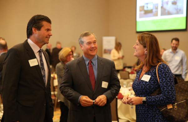 Senator Ryan Mischler talks with PHM Board Pres. Gary Fox & Asst. Supt. Heather Short at the 2017 Superintendent's Luncheon